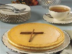 Pumpkin-Cake with serving plates and silverwear