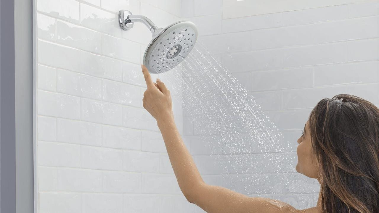 person in shower adjusting shower head Specta-e touch
