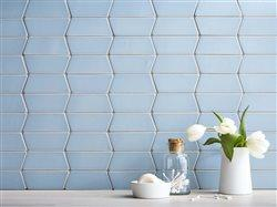 BBRadius Wedge Silver Blue Matte tile with flower arrangement in front of it