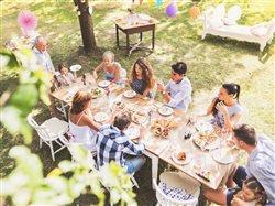 family enjoying an outdoor celebration
