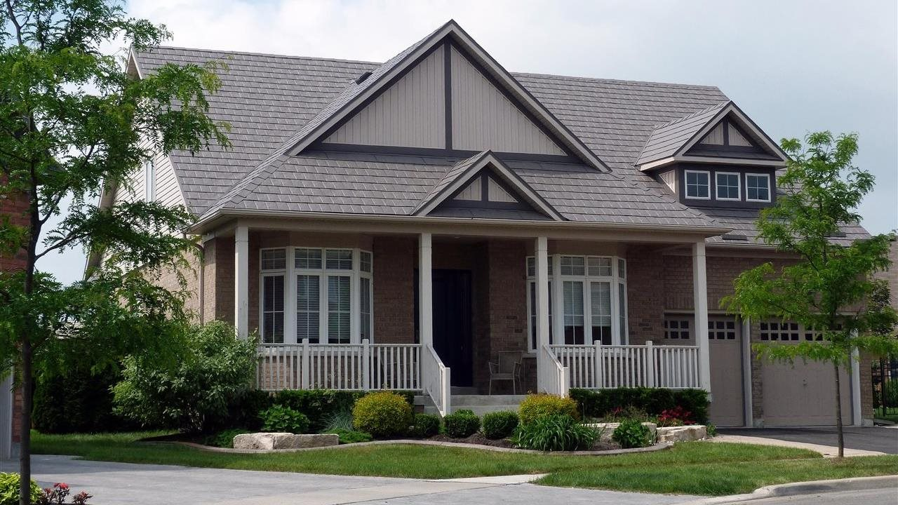 beautiful house with gables and a front porch and metal roof