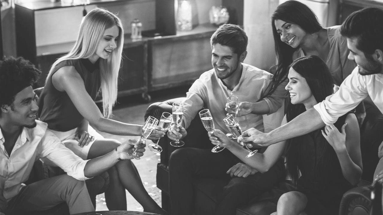 friends enjoying champagne at a red-carpet awards party at home
