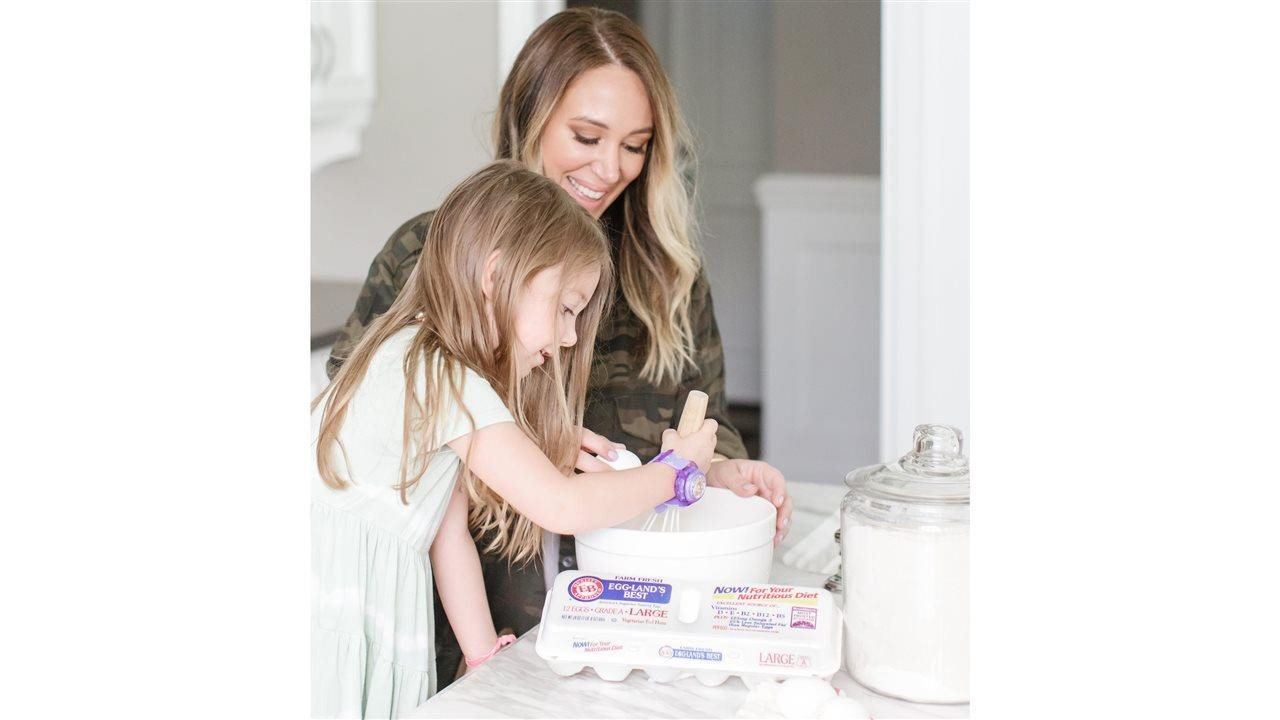 Haylie Duff and little girl mixing eggs in a bowl