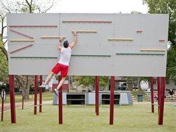 expert ninja John Wilmas training on wall