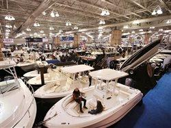 people at a large boat show