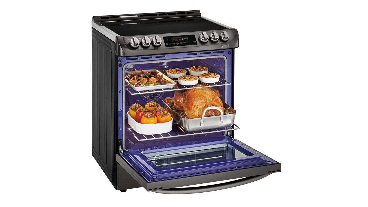 huge oven eith turkey, and 3 side dishes baking at the same time
