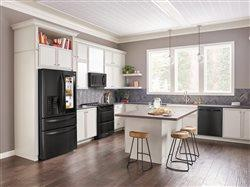 Large kitchen with black appliances and a center island
