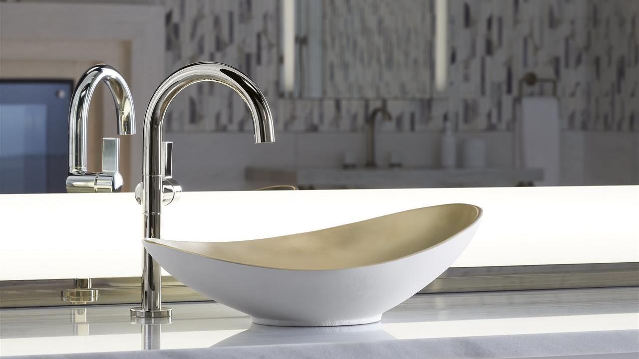 beautiful faucet and unique wash bowl