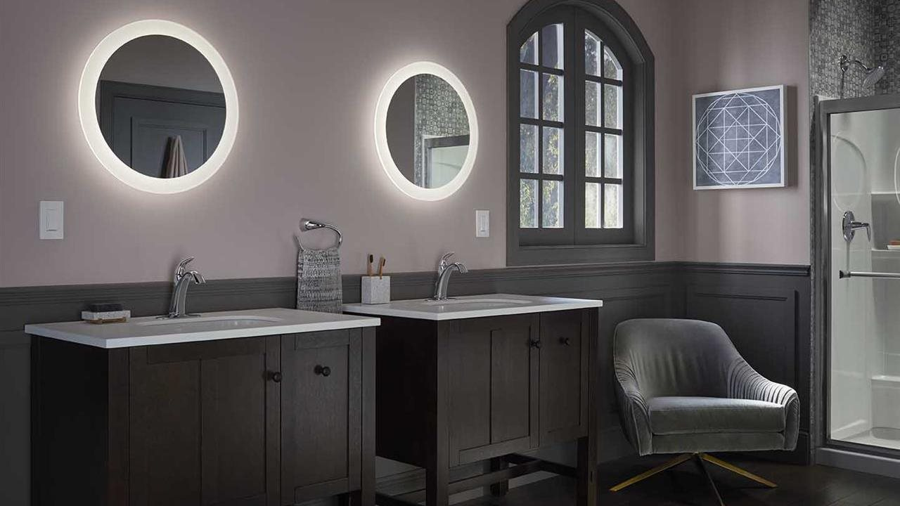 twin sinks and shower with coordinating faucets in modern style bath