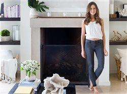 woamn standing near a fireplace in a living room