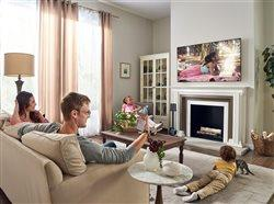 family watching tv in the living room using AI