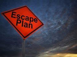 sign under stormy sky that says escape plan