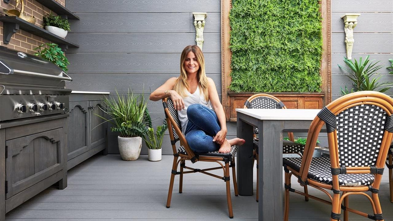 woman sitting in creative outdoor kitchen