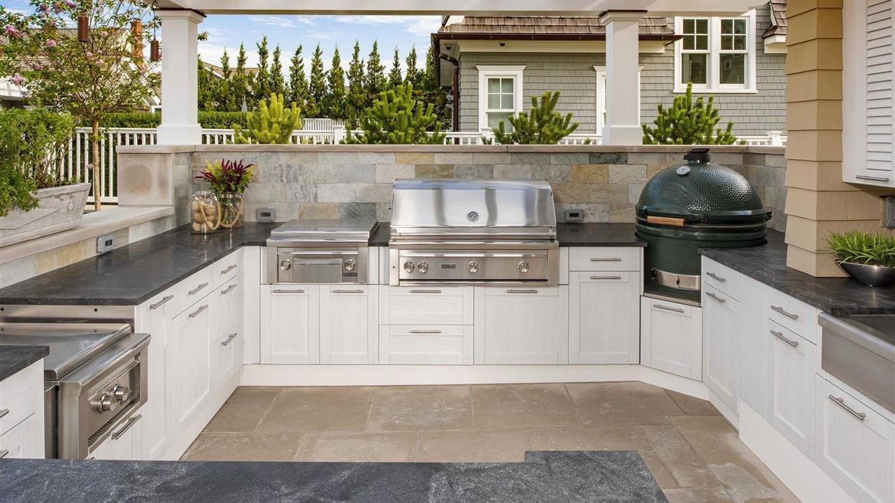 beautiful outdoor kitchen under pergala