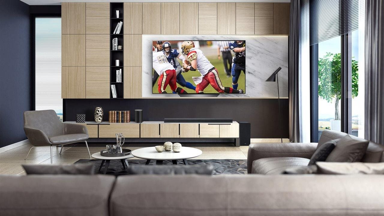 Large screen tv playing foot ball game in modern living room
