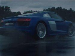 Professional driver driving car in the rain