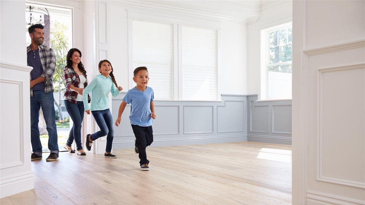Family entering potential new home