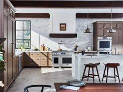large upscale kitchen with beauitiful appliances