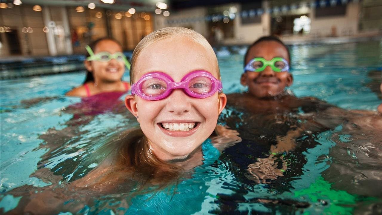 kids with goggles swimming in a pool