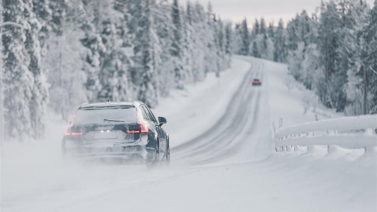 car traveling on a snowy road in the winter