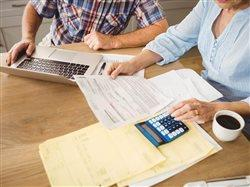 mature couple working on budget
