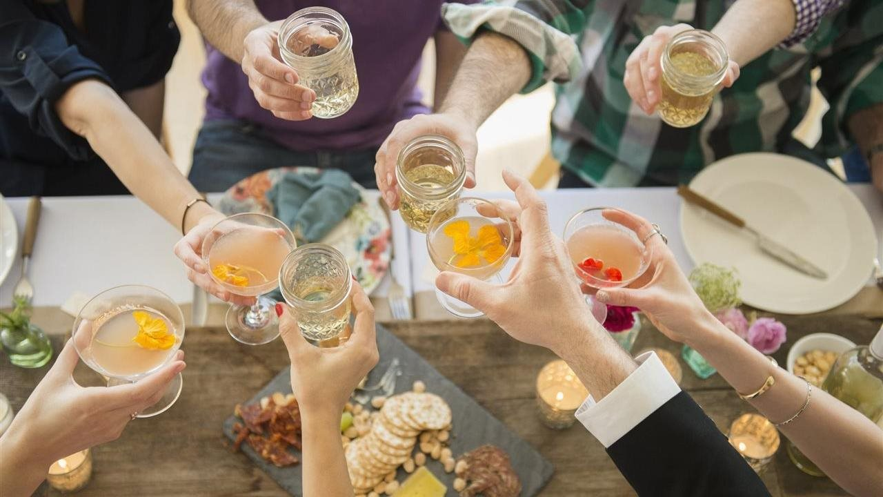 people celebrating at a party with wine