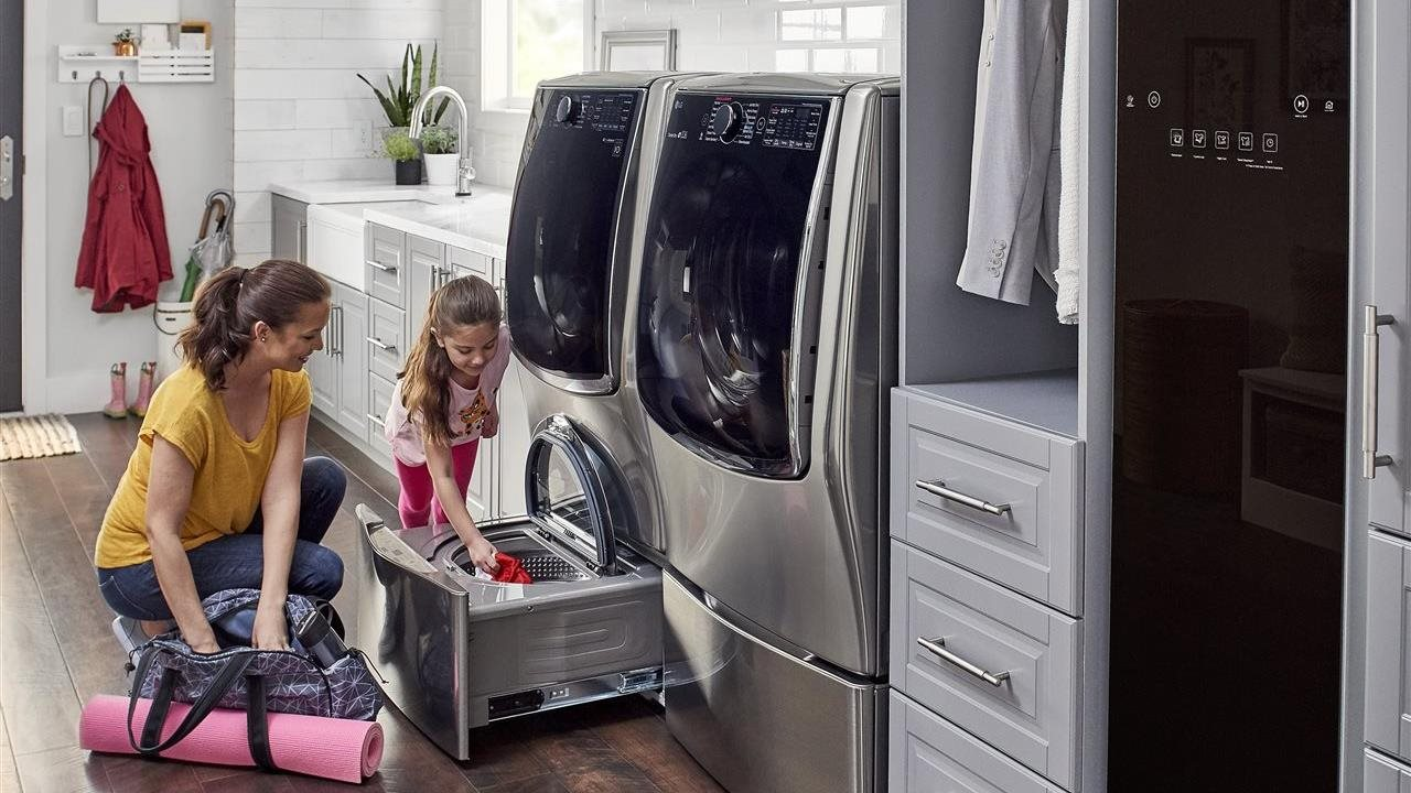 Mom and daughter doing the laundry together