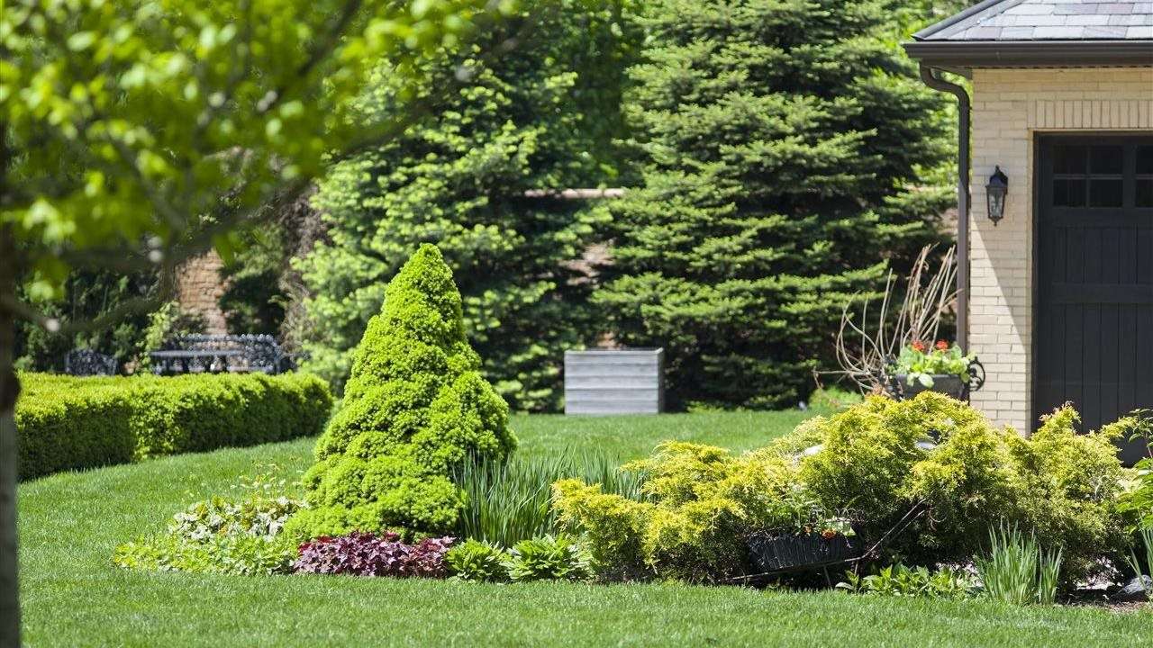 Spring lawn and land scaping by a garage