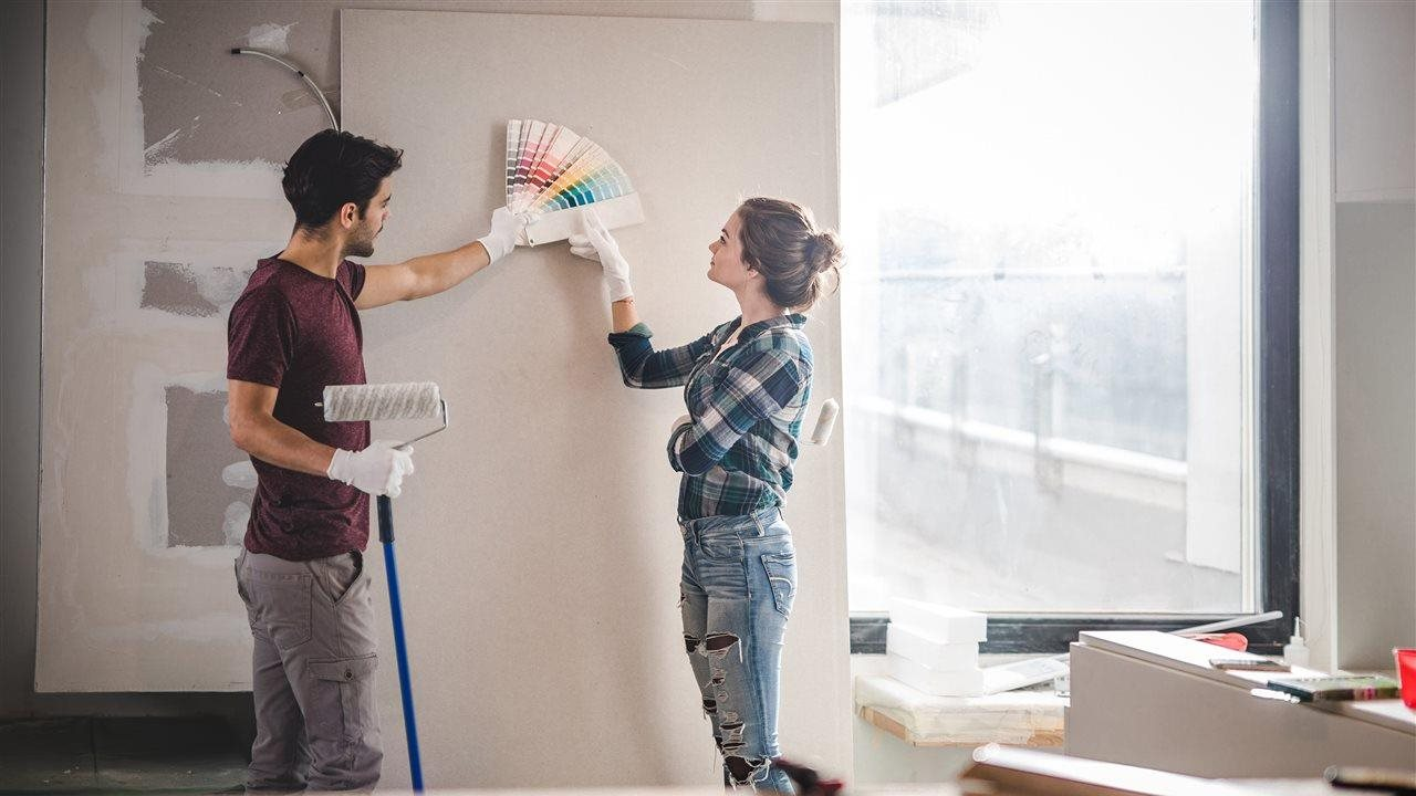 couple choosing new color for the walls in their home