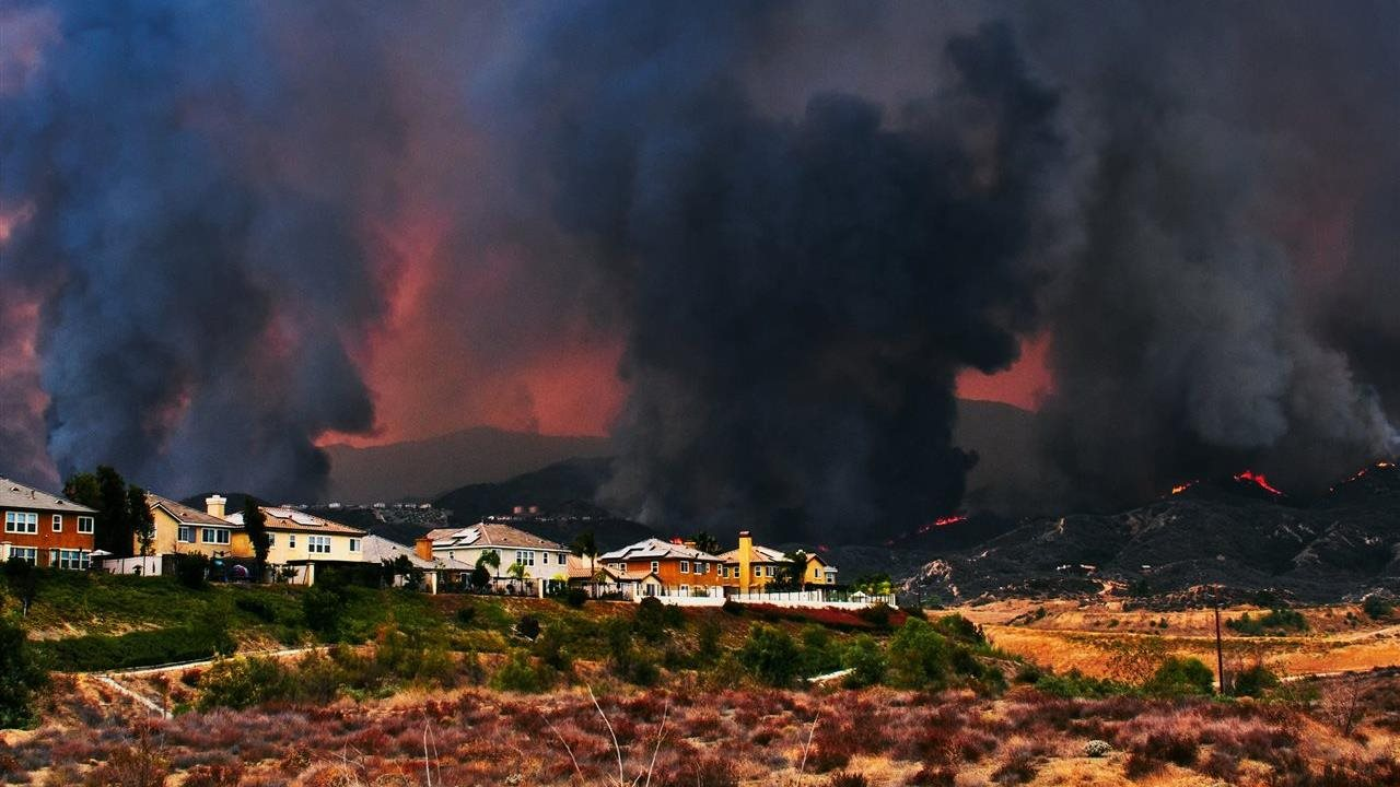 wild fire threatening homes and property
