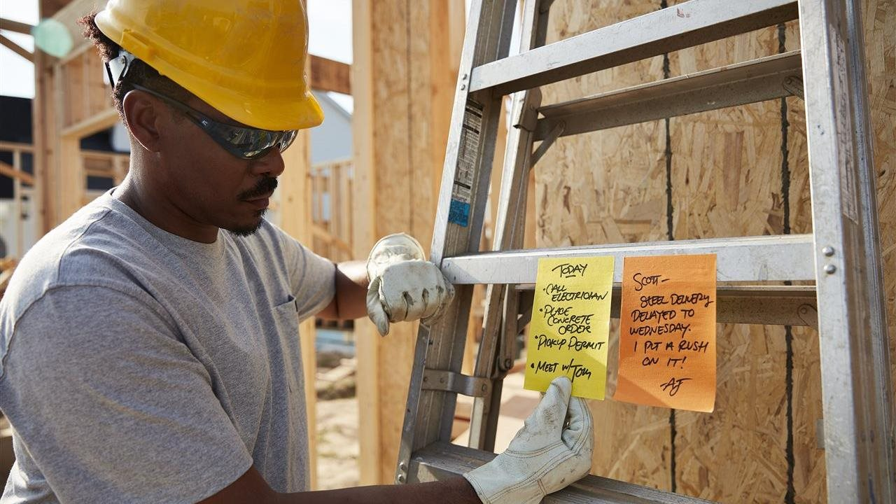 man in hard hat reading Post-it Extreme XL Notes on ladder at construction site