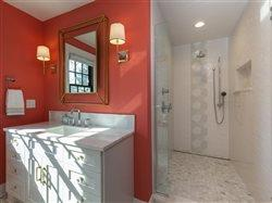 QuickDrain in beautiful upscale bath with orange accent wall