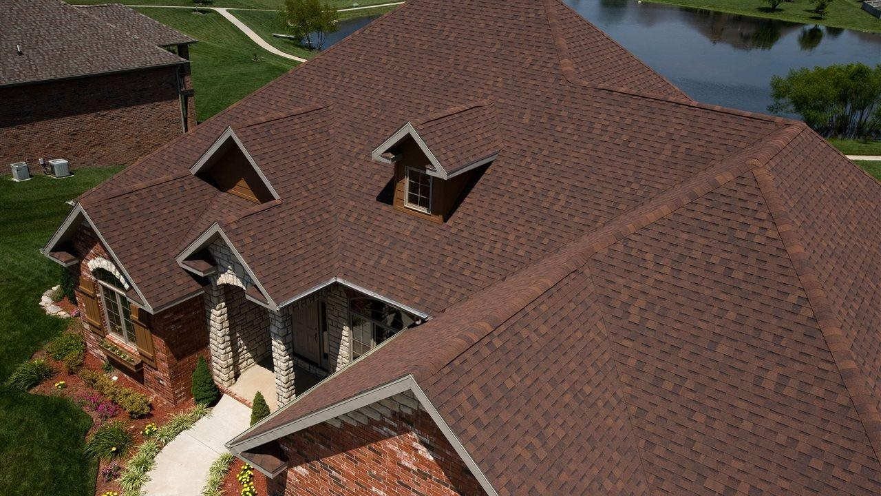 TAMKO Heritage Rustic Hickory (Classic) roof on large home with pond in back yard