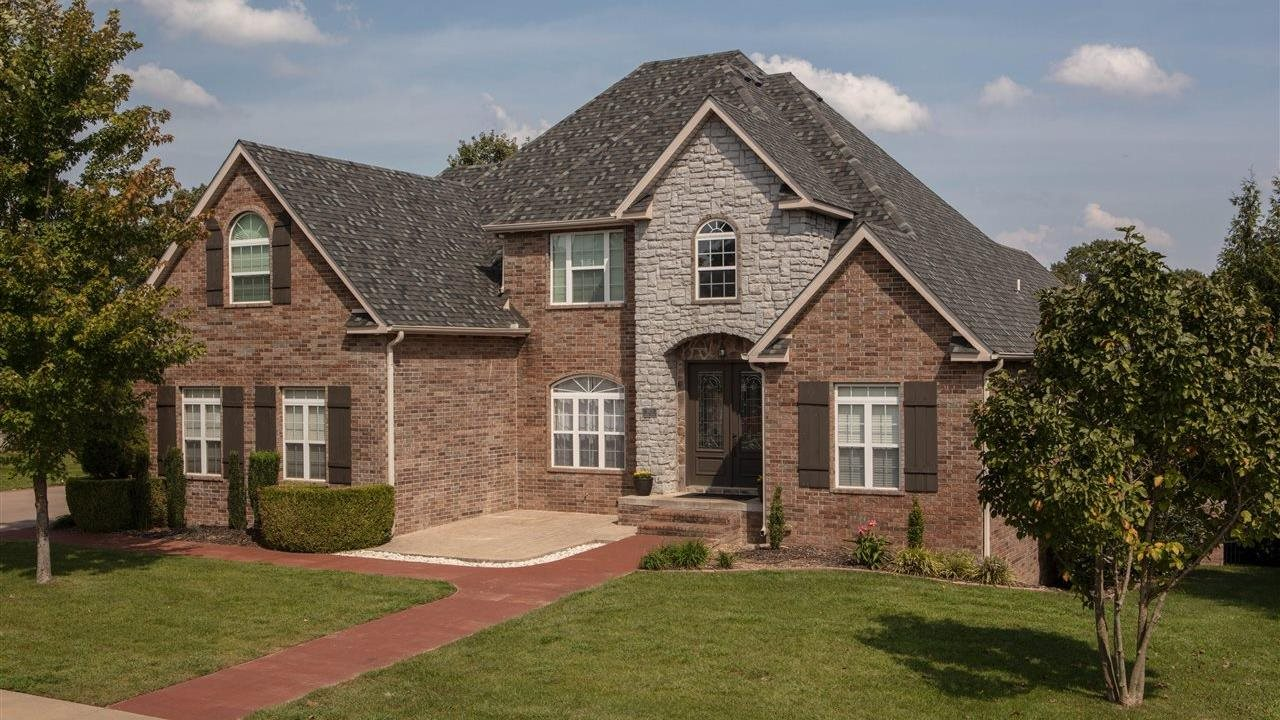 Hertigae IR Thunderstorm grey shingles on large upscale home