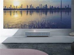 LG CineBeam AI ThinQ 4K Laser Projector on shelf in living room.
