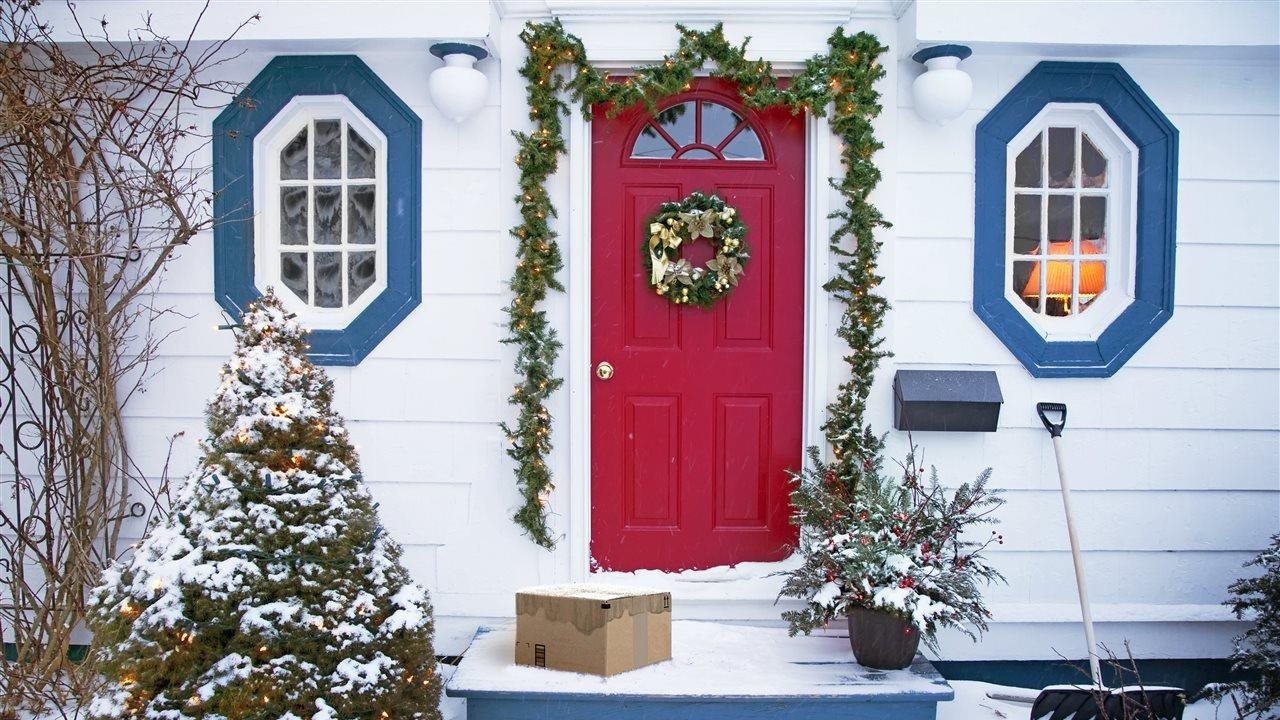 house with package on steps during the holidays