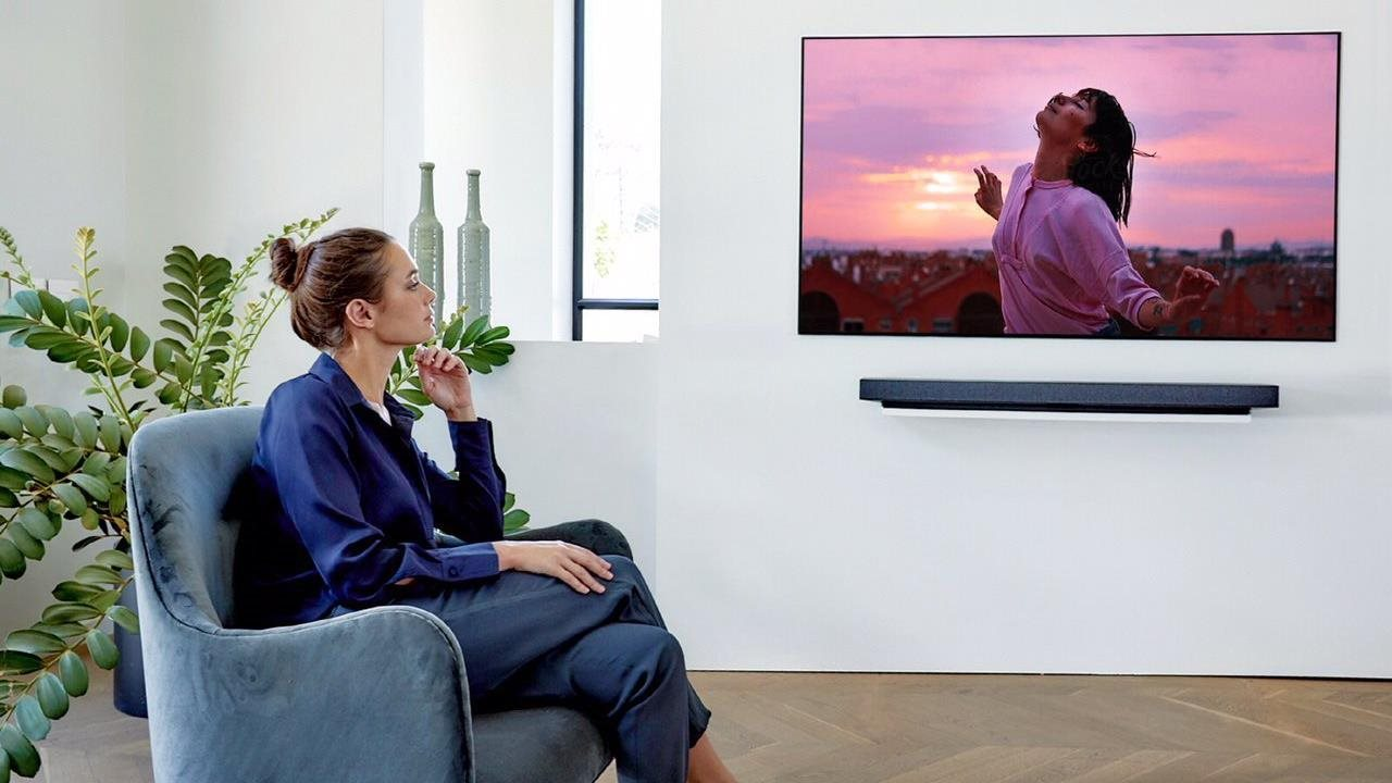 Woman watching large screen TV