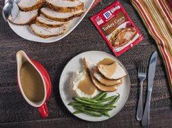 Turkey gravy on turkey and mash potatoes and in gravy boat