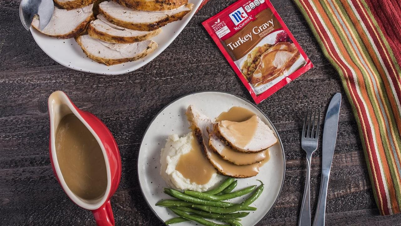 Turkey gravy on turkey and mash potatoes and in gravy boat