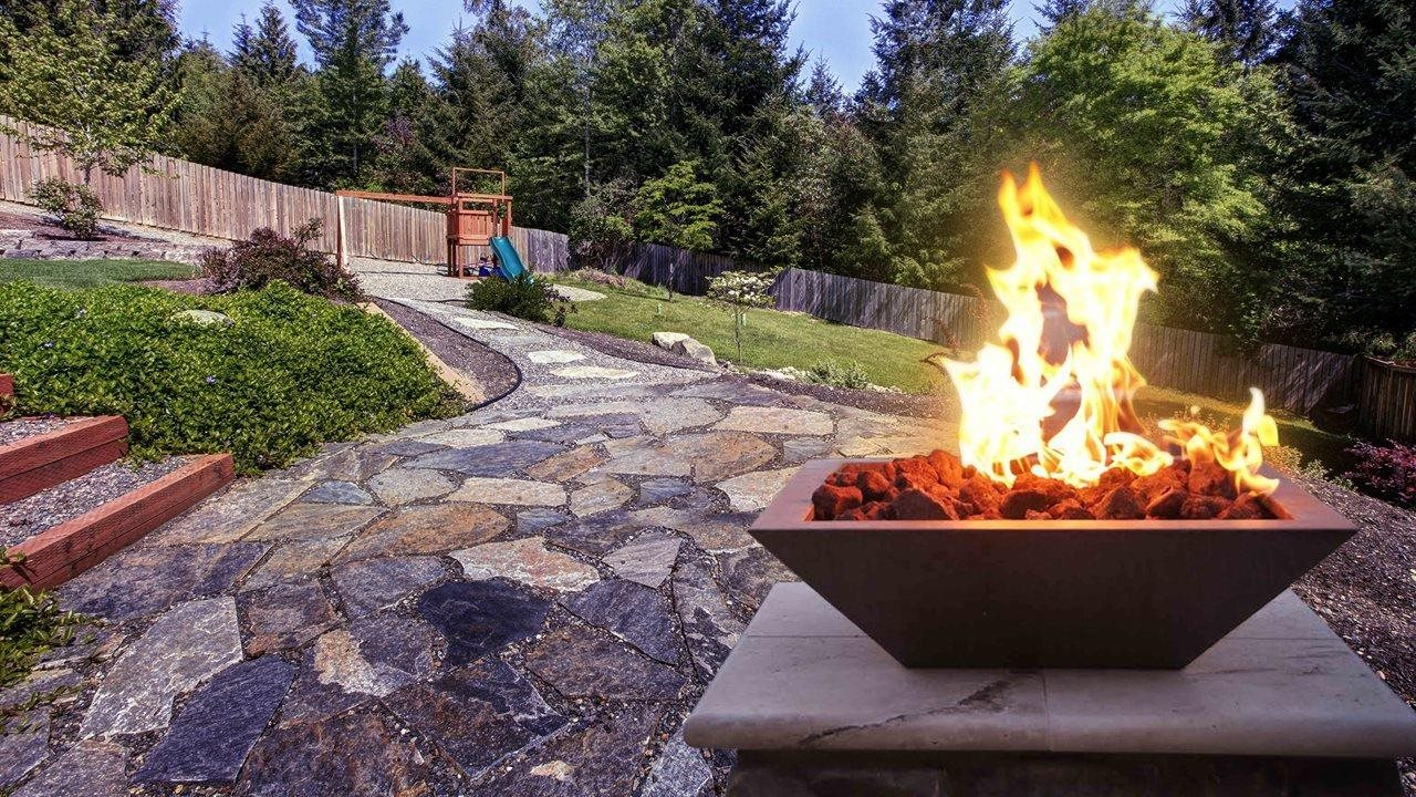 Fire feature in backyard of home