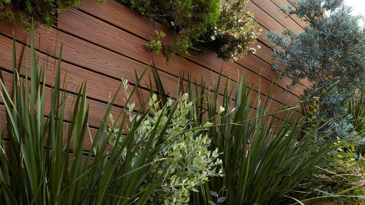 vertical garden using trex decking for flower boxes