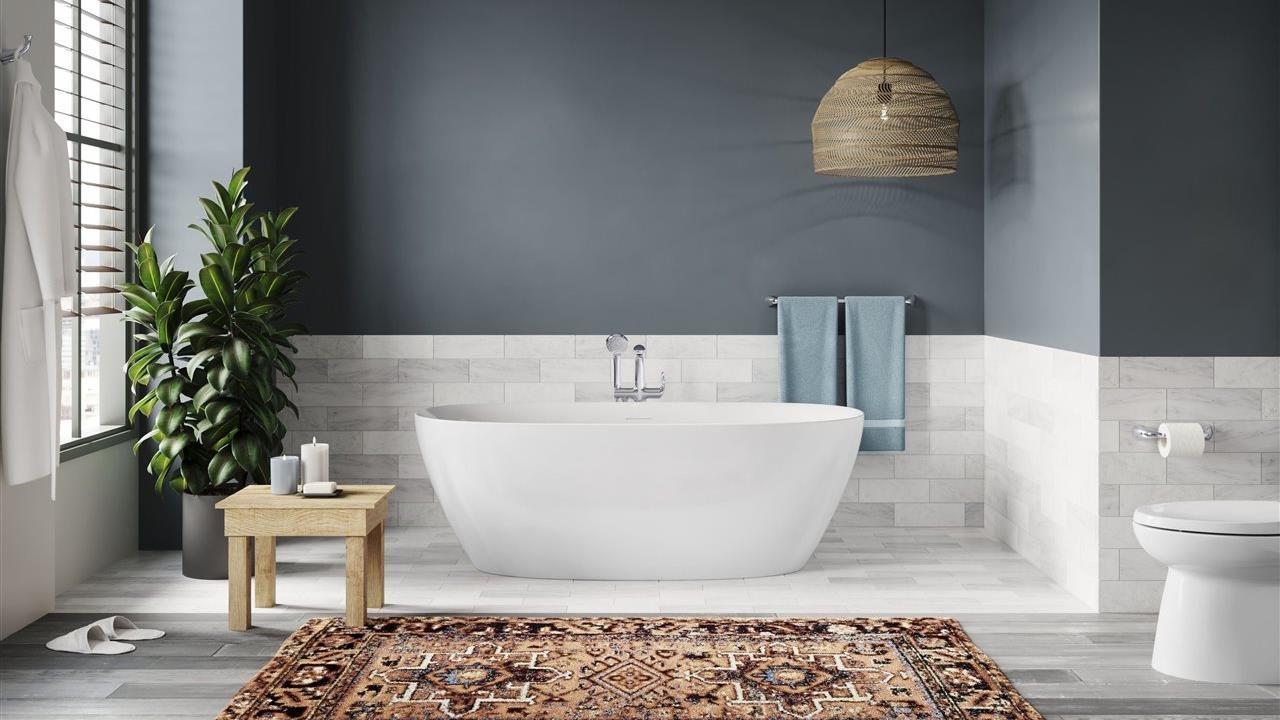 Sterling Unwind oval tub in large bath