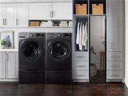 LG washer dryer set with mirror styler in ultimate laundry room