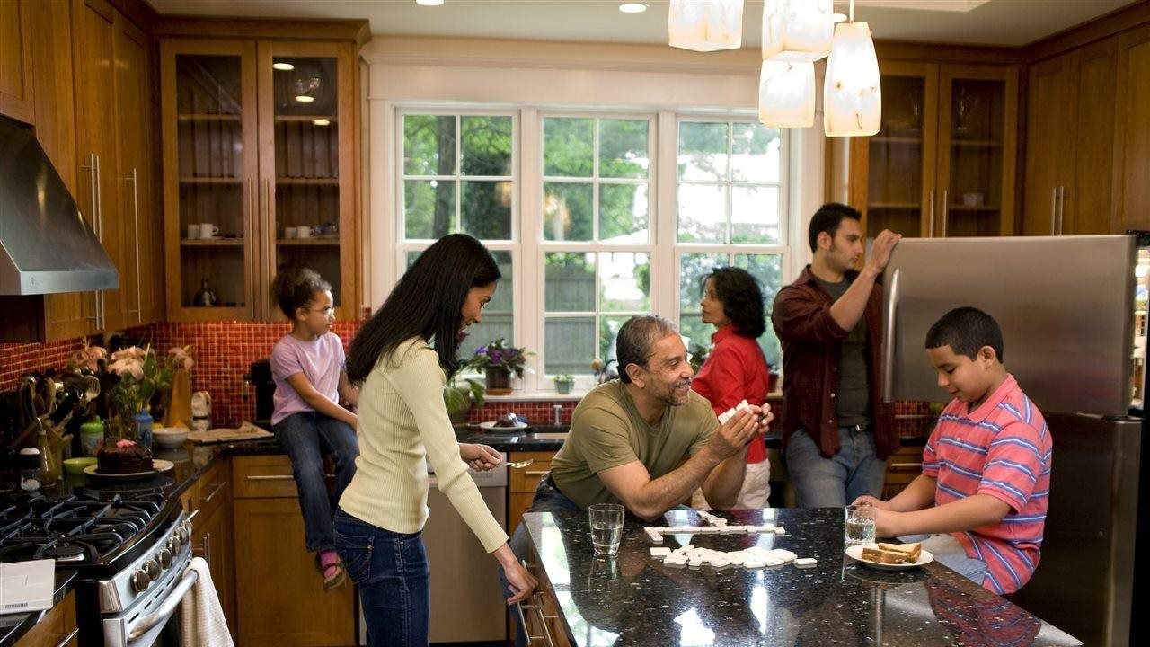 multi-generational family enjoying making meal together
