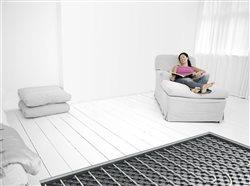 woman relaxing in a room with under floor heating