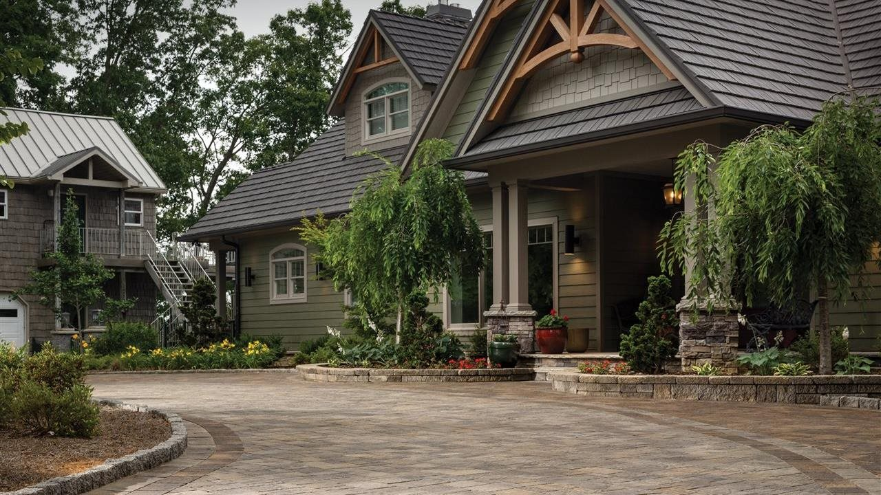 Beautiful craftsmen style home with circular paver driveway