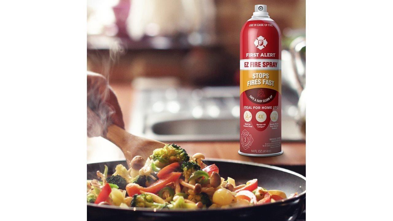 first alert fire spray next to pan of stir fry in kitchen