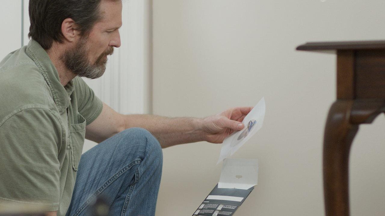 Man looking at dap guide in livingroom