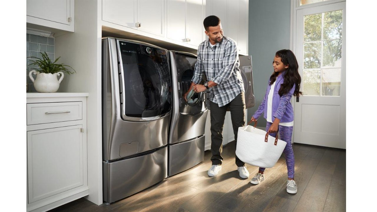 dad and daughter doing the laundry