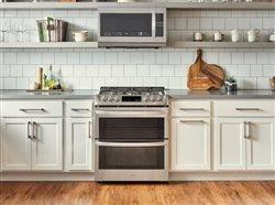 Lg range and microwave in kitchen